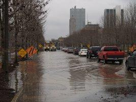 One lane of traffic through Headwaters Park on Clinton Street