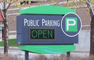 Parking sign near Headwaters Park.