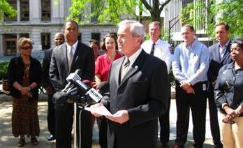 Mayor Tom Henry announcing his appointment of Vince Robinson as Public Information Director.  Courtesy photo.